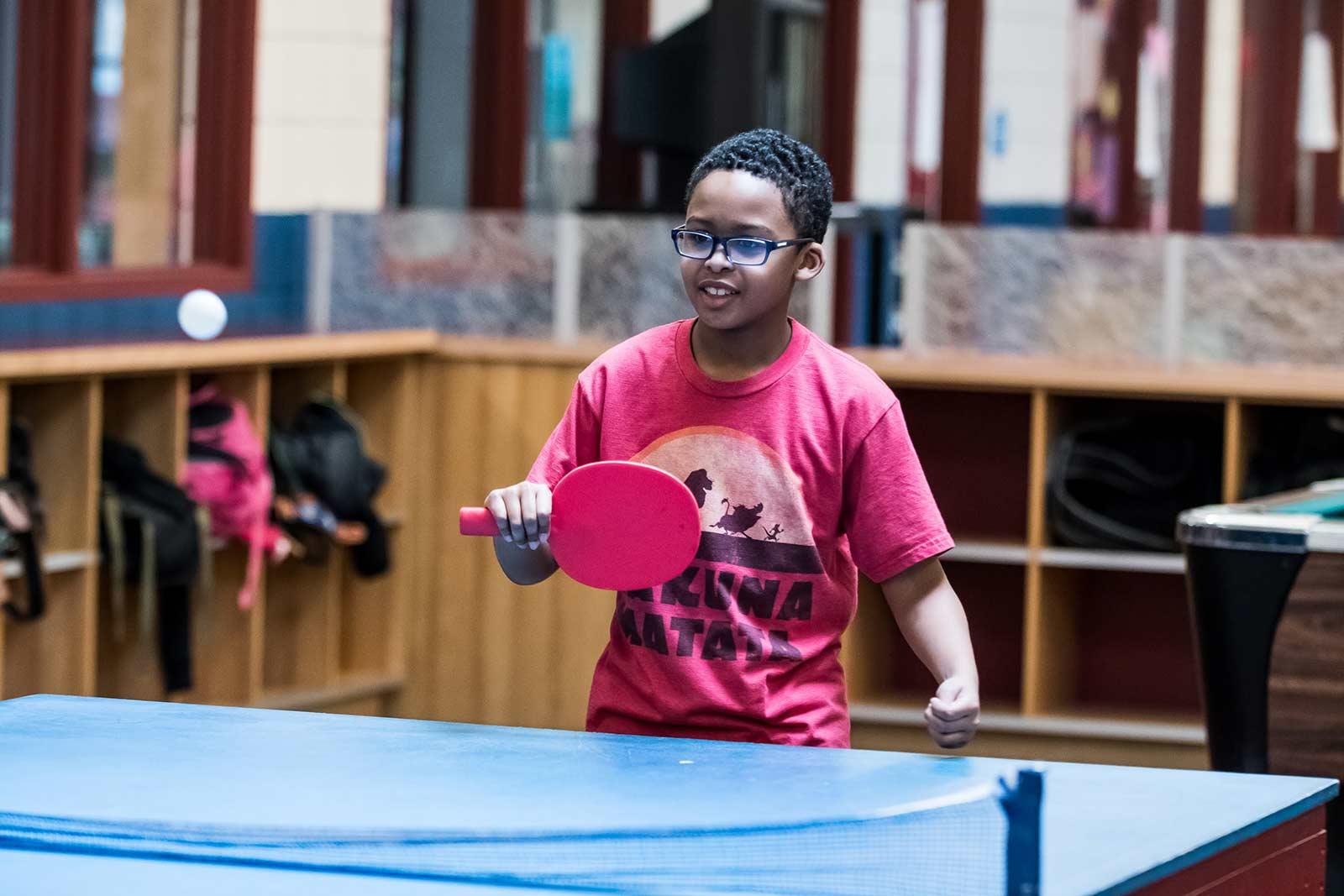 boy playing pingpong at Boys & Girls Club of Pawtucket